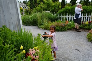 Watering the flowers in the children's garden at CMBG