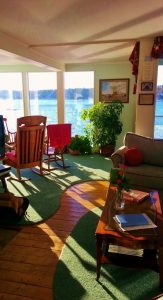 from the livingroom into the sunroom looking out at Linekin Bay