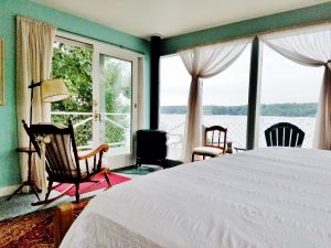 View from the rocking chair next to the bed in the Master bedroom with a view across Linekin Bay