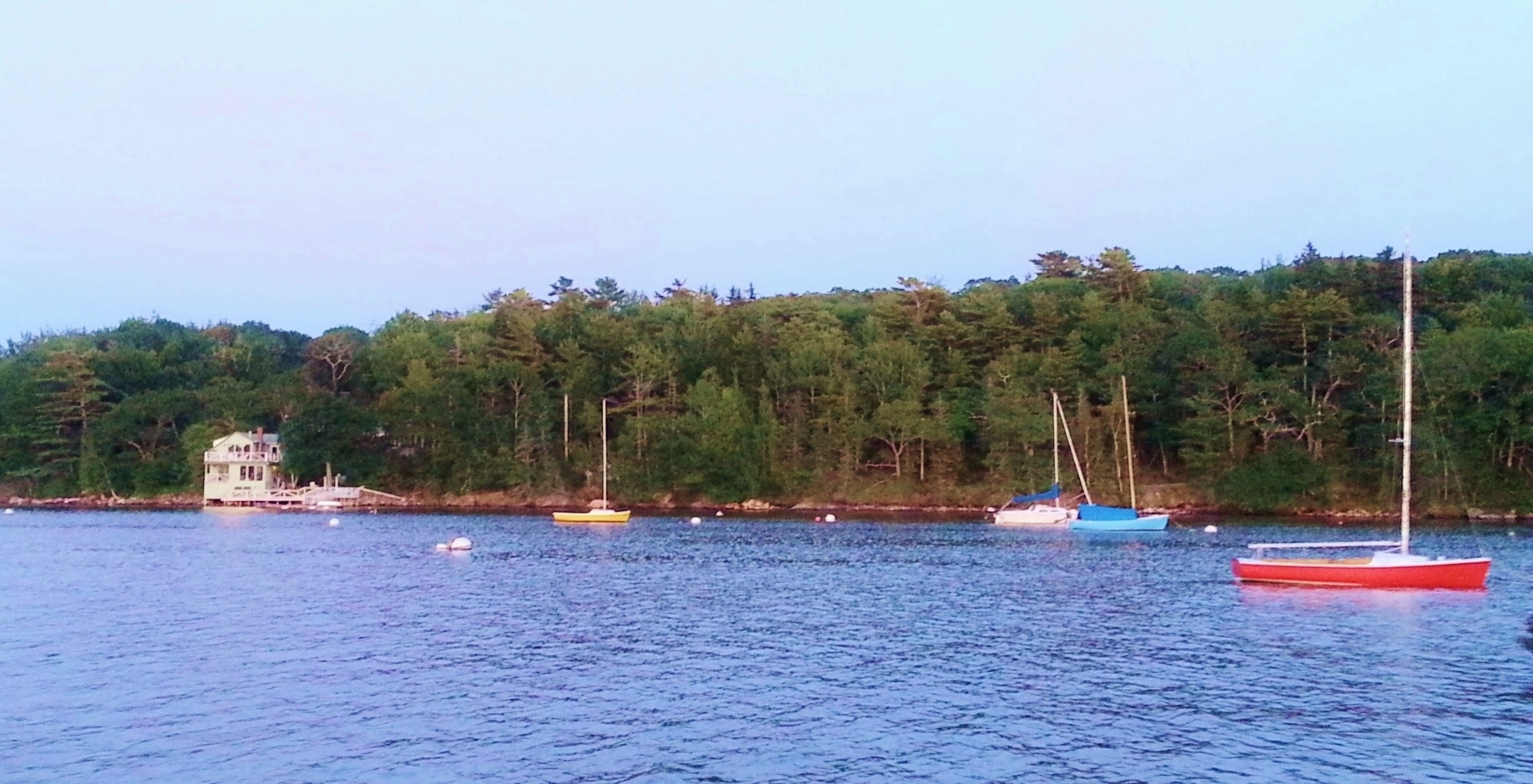 Approaching Seanook in the evening by boat across Linekin Bay