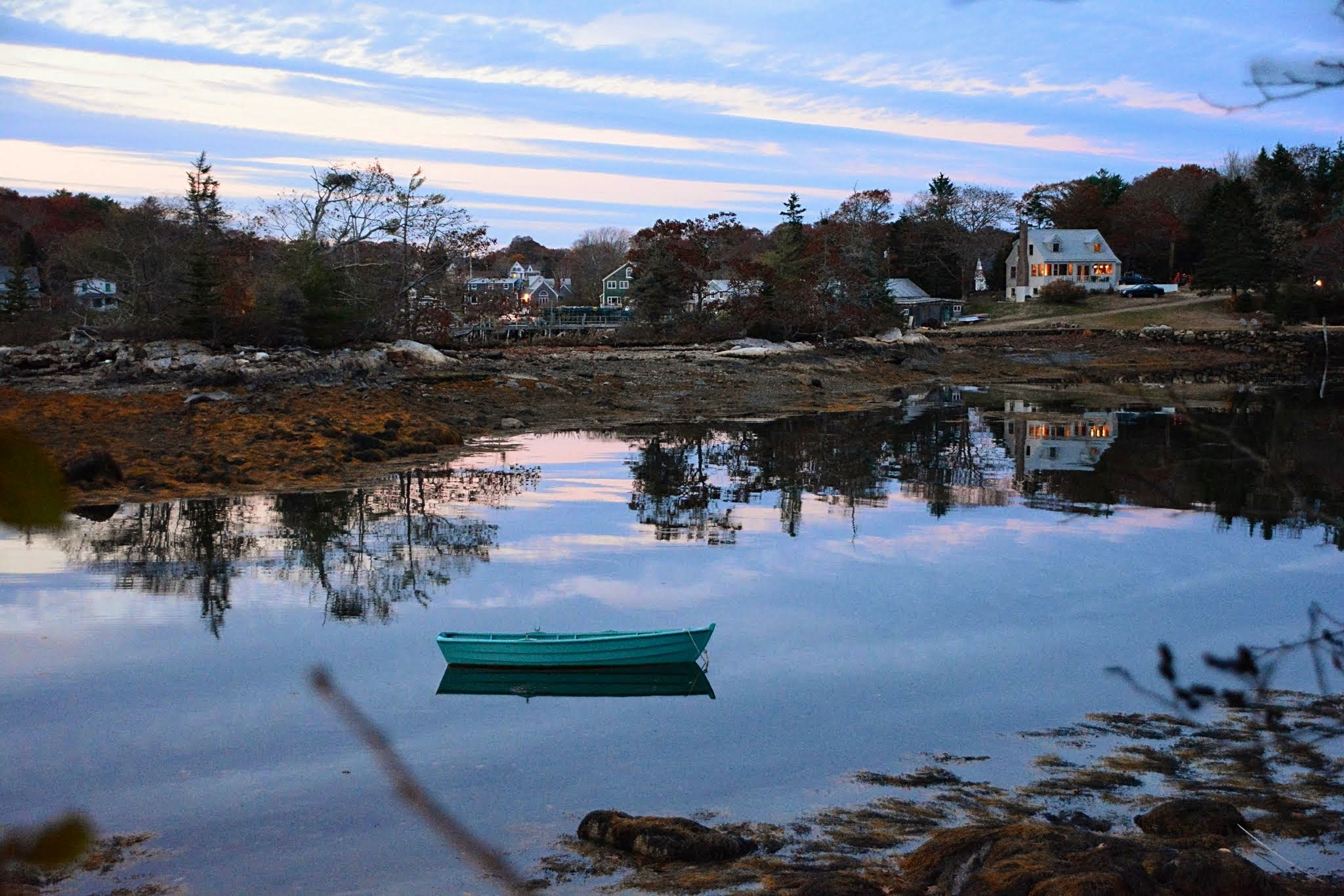 Our rowboat moored in the cove, evening.
